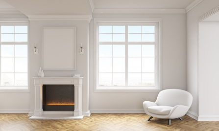 Front view of classic living room interior with wooden floor, white armchair, windows with city view and a blank picture frame above fireplace. Mock up, 3D Rendering