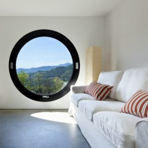 beautiful modern house in cement ,room with large porthole